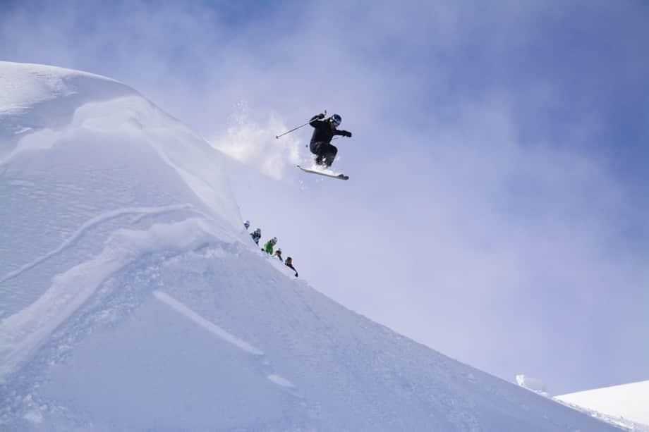 skier on cliff drop whistler