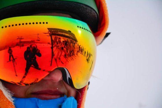 man wearing reflective ski goggles